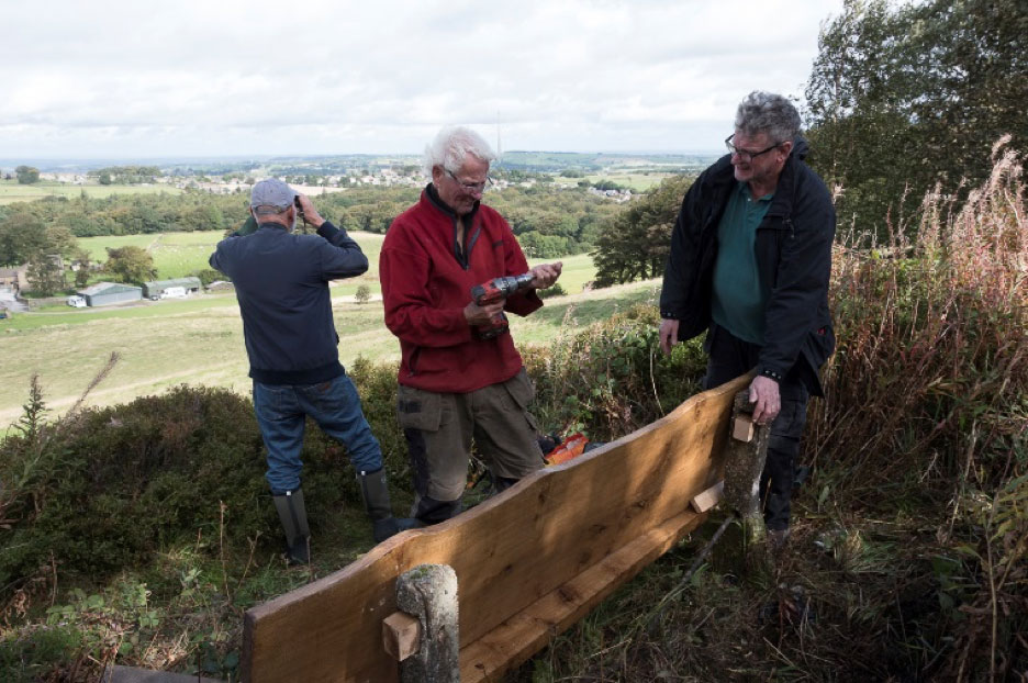 Walkers are Welcome repairing a bench in High Flatts